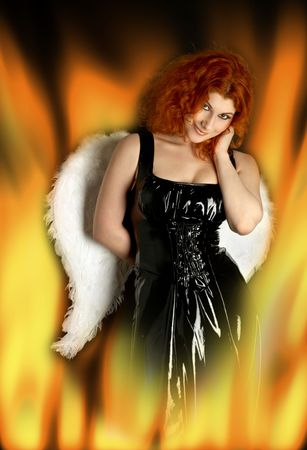 black latex dress girl with angel wings in fire Stock Photo - 909556