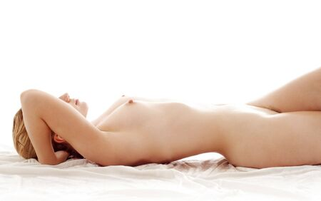 undressed young: classical picture of healthy naked woman in bed Stock Photo