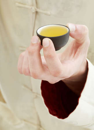 picture of hand holding cup of green tea Stock Photo - 930094