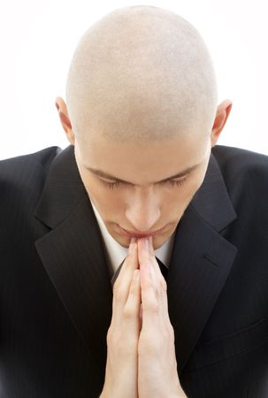 portrait of praying man in black suit over white photo