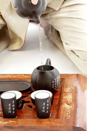 kneeled: closeup picture of tea ceremony set in action