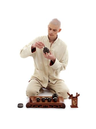 kneeled: picture of tea ceremony master over white background Stock Photo