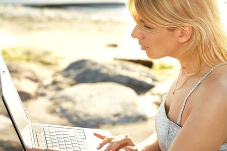 outdoor picture of lovely blond with laptop  photo