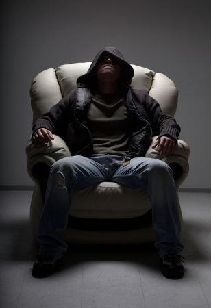 dark portrait of dangerous man sitting in white chair Stock Photo - 938974