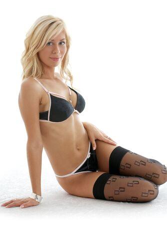 lovely blond in black lingerie over white