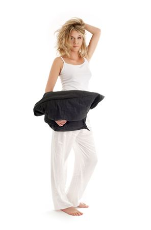 happy blond with black pillow over white Stock Photo - 960675