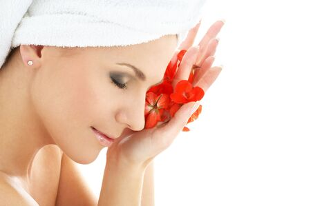 remedial: happy woman with red flower petals in spa