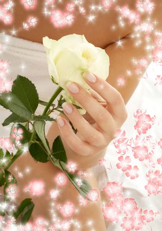 beautiful woman hand with rosebud surrounded by rendered flowers photo