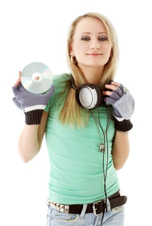 urban teenage girl with headphones holding cd over white photo