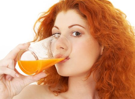 picture of lovely redhead drinking orange juice Stock Photo - 1005057