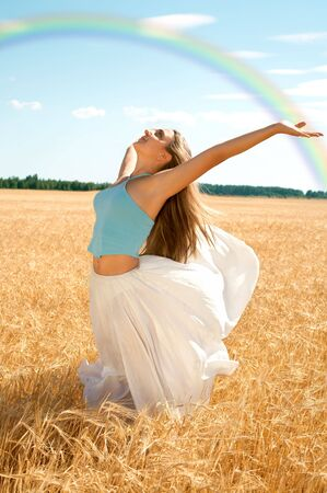 fit girl working out at the field under rainbow Stock Photo - 1050928