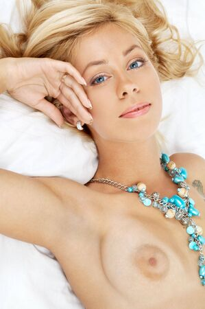 nice breast: portrait of lovely lady laying in bed