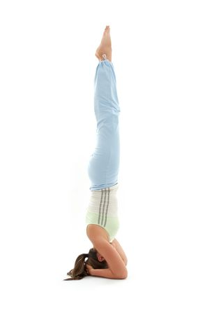 sporty girl practicing salamba sirsasana supported headstand photo