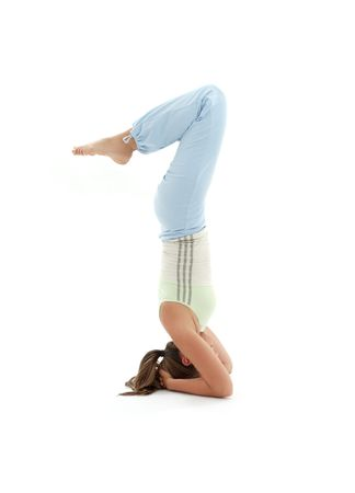 sporty girl practicing salamba sirsasana supported headstand Stock Photo - 1050936