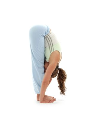 stretch out: sporty girl practicing uttanasana standing forward bend Stock Photo