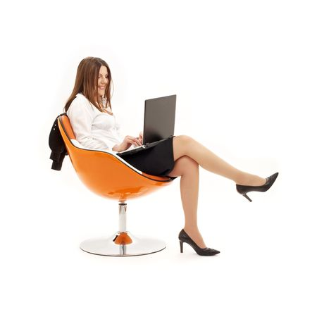 businesswoman with laptop in orange chair over white Stock Photo - 1080582