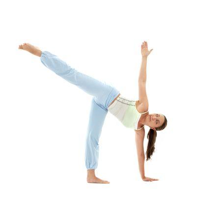 chandrasana: sporty girl practicing ardha chandrasana half moon pose