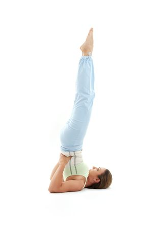 sporty girl practicing salamba sarvangasana supported shoulderstand photo
