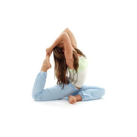 lovely girl practicing ashtanga yoga over white photo