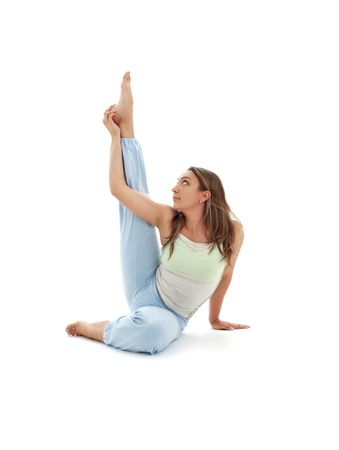 girl practicing krounchasana heron pose over white Stock Photo - 1193629