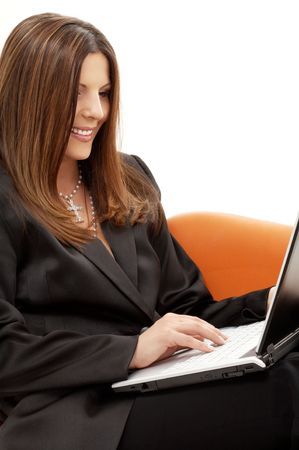 businesswoman with laptop in orange chair over white Stock Photo - 1193633