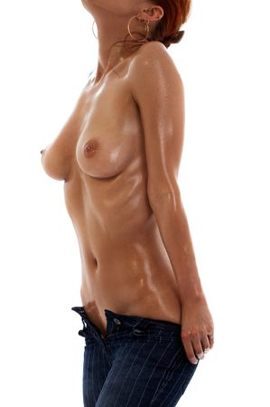 wet breast: topless girl in blue jeans torso over white