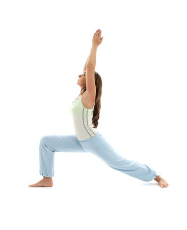 sporty girl practicing virabhadrasana warrior pose over white photo
