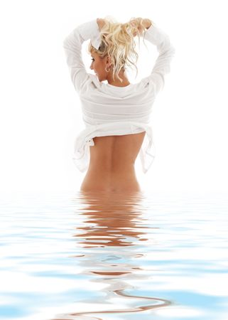 picture of lovely blond in water pulling hair up photo