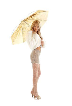 lovely girl with golden umbrella over white Stock Photo