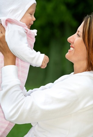 outdoor picture of happy mother with baby (focus on mom) Stock Photo - 1478153