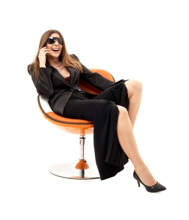 businesswoman with phone in orange chair over white photo
