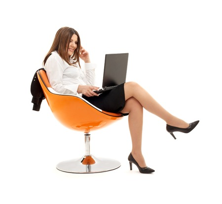 businesswoman with laptop in orange chair over white photo