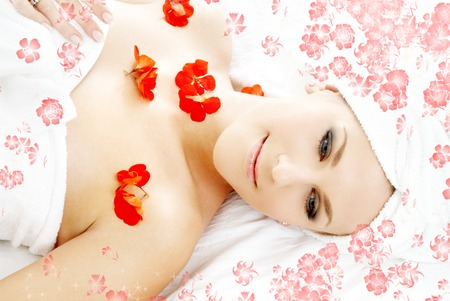 beautiful lady with red flower petals in spa Stock Photo - 1511987
