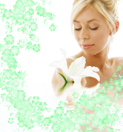pretty lady with madonna lily in water photo