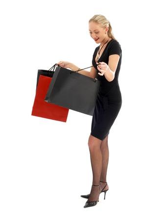 euphoric: Euforico biondo con le borse della spesa su bianco  Archivio Fotografico