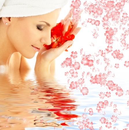 lovely woman with red flower petals in water photo