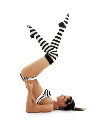 supported: striped underwear girl practicing salamba sarvangasana supported shoulderstand Stock Photo