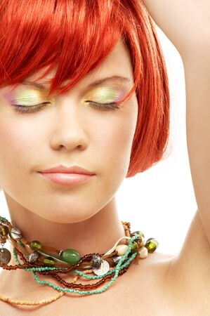 carnal: picture of green beads redhead with eyes closed