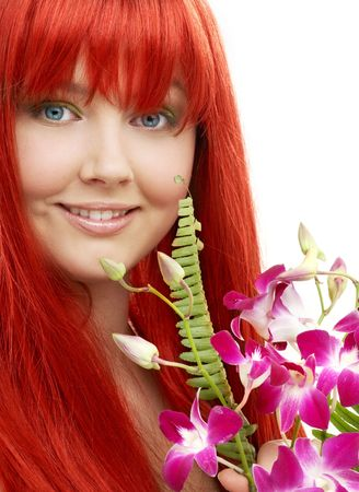 bright picture of lovely redhead with orchid photo