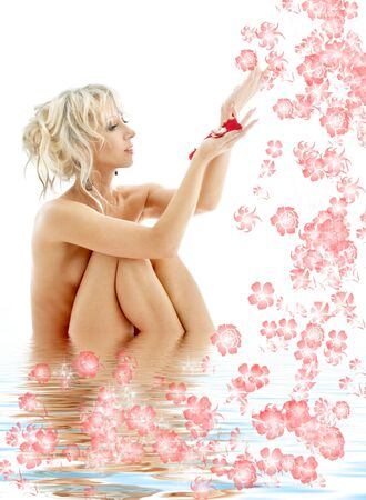 aqua naked: lovely naked blond with rose petals relaxing in water