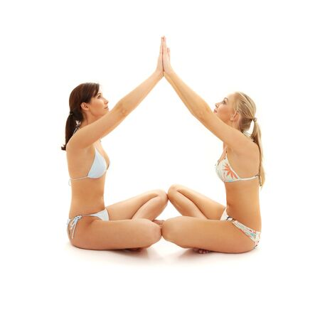 two girls with hands connected making home symbol photo