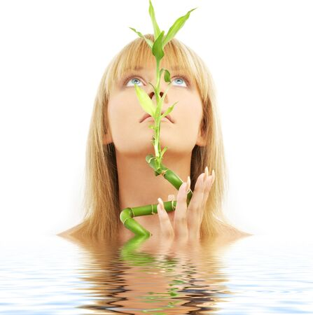 bright picture of lovely blond with bamboo in water Stock Photo - 1788332