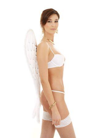 lovely brunette in white lingerie with angel wings Stock Photo - 1797802