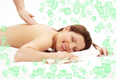 picture of lovely lady relaxing in massage salon with green flowers Stock Photo