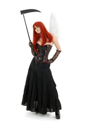 latex girl: lovely redhead with angel wings and scythe Stock Photo