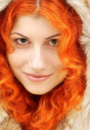 red head girl: closeup portrait of lovely redhead in fur