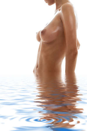 wet breast: picture of  girl torso in water Stock Photo