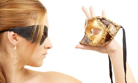 women face stare: portrait of  beautiful young woman holding venetian carnival mask