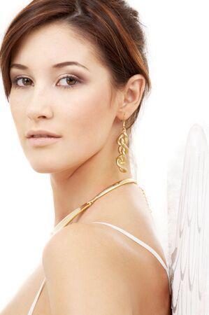 portrait of brunette angel girl in white lingerie