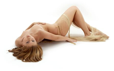classical artistic nudity picture of naked girl with golden fishnet Stock Photo